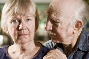 Close Up Portrait of Worried Senior Couple